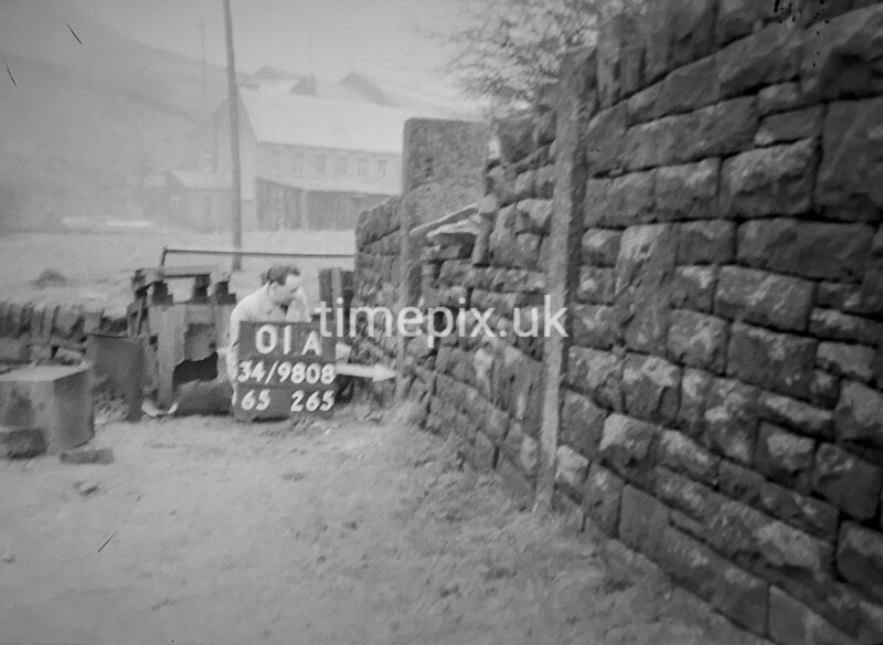 SD980801A1, Man marking Ordnance Survey minor control revision point with an arrow in 1950s