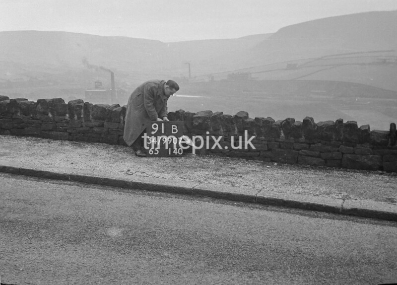 SD990791B, Man marking Ordnance Survey minor control revision point with an arrow in 1950s