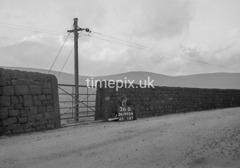 SD990836B, Man marking Ordnance Survey minor control revision point with an arrow in 1950s