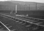 SD990653K1, Man marking Ordnance Survey minor control revision point with an arrow in 1950s