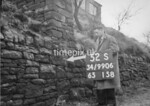 SD990652S2, Man marking Ordnance Survey minor control revision point with an arrow in 1950s