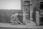 SD980727B, Man marking Ordnance Survey minor control revision point with an arrow in 1950s