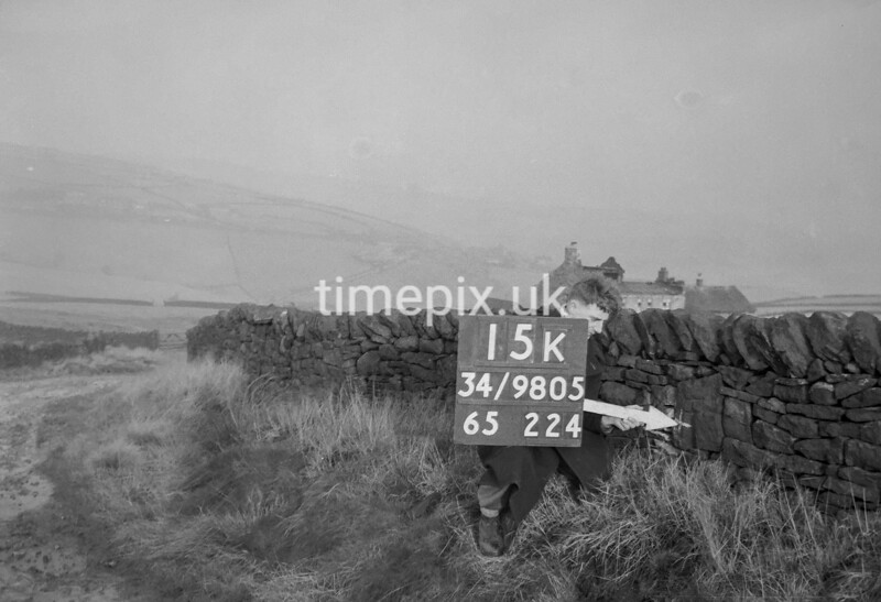 SD980515K, Man marking Ordnance Survey minor control revision point with an arrow in 1950s