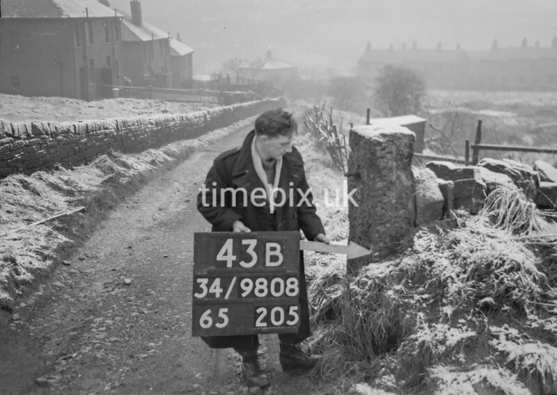 SD980843B, Man marking Ordnance Survey minor control revision point with an arrow in 1950s