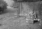 SD990635K, Man marking Ordnance Survey minor control revision point with an arrow in 1950s