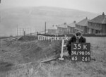 SD980635K, Man marking Ordnance Survey minor control revision point with an arrow in 1950s