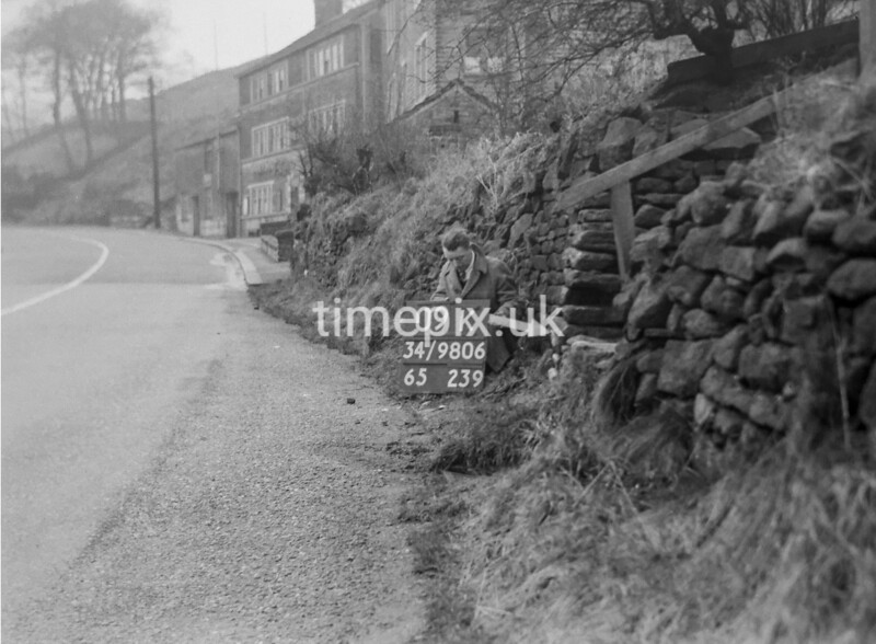 SD980609K, Man marking Ordnance Survey minor control revision point with an arrow in 1950s