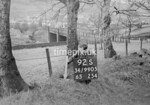 SD990592S, Man marking Ordnance Survey minor control revision point with an arrow in 1950s