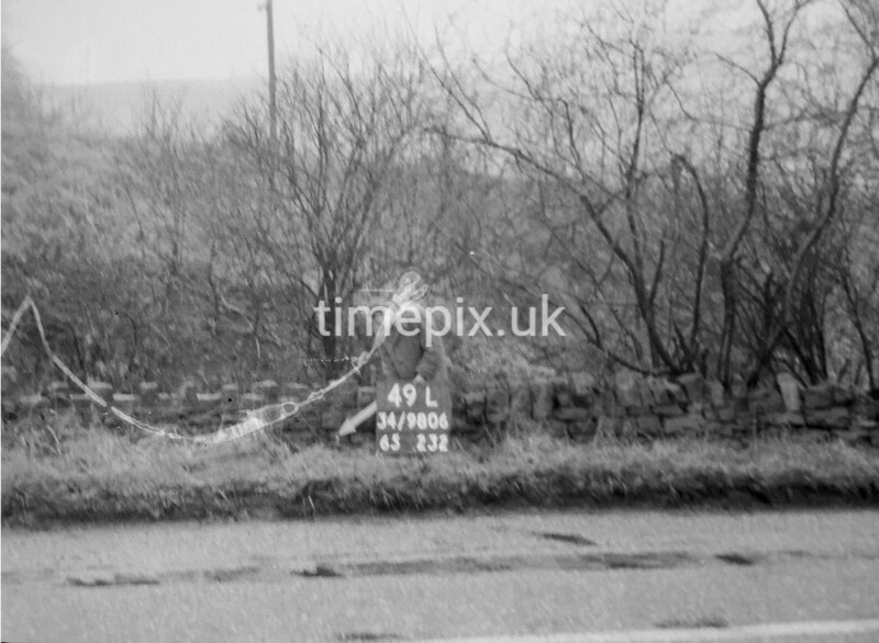 SD980649L, Man marking Ordnance Survey minor control revision point with an arrow in 1950s