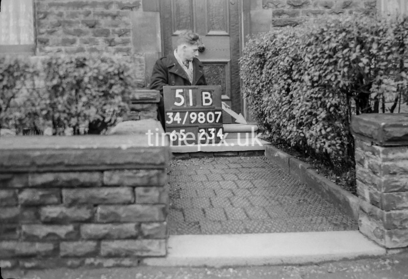 SD980751B, Man marking Ordnance Survey minor control revision point with an arrow in 1950s