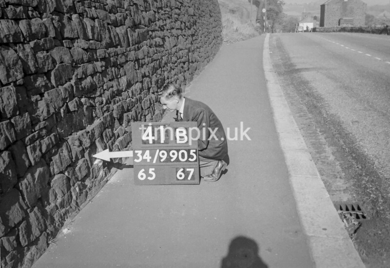 SD990541B, Man marking Ordnance Survey minor control revision point with an arrow in 1950s
