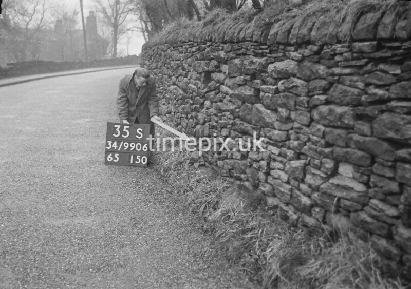 SD990635S2, Man marking Ordnance Survey minor control revision point with an arrow in 1950s
