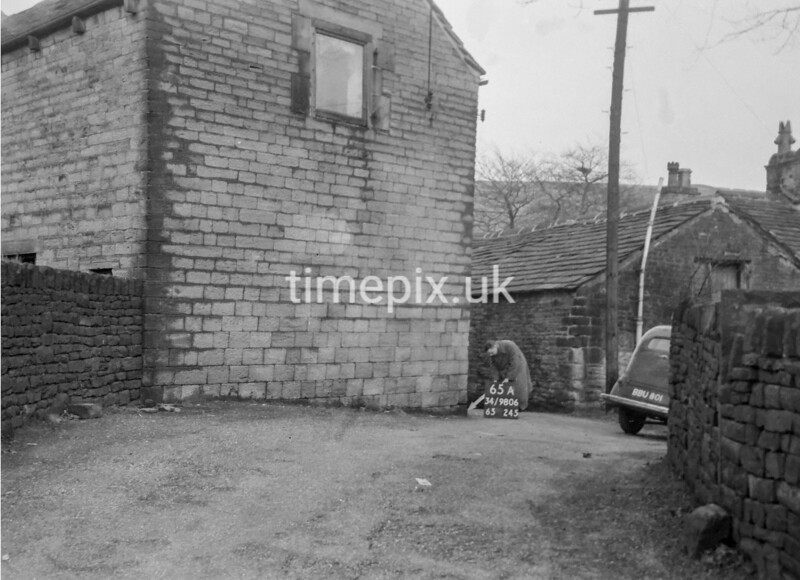 SD980665A, Man marking Ordnance Survey minor control revision point with an arrow in 1950s