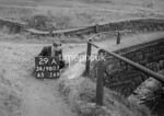 SD980729A, Man marking Ordnance Survey minor control revision point with an arrow in 1950s