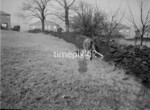 SD980645A, Man marking Ordnance Survey minor control revision point with an arrow in 1950s