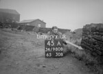 SD980845A, Man marking Ordnance Survey minor control revision point with an arrow in 1950s