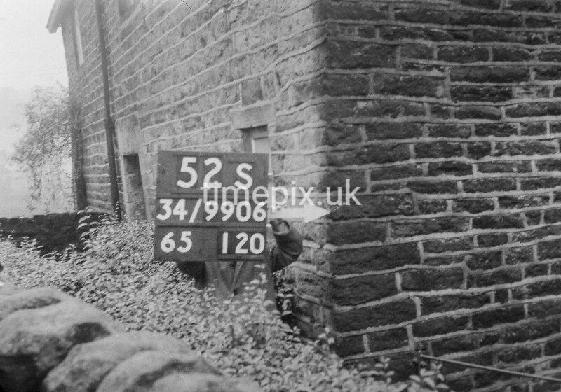 SD990652S1, Man marking Ordnance Survey minor control revision point with an arrow in 1950s