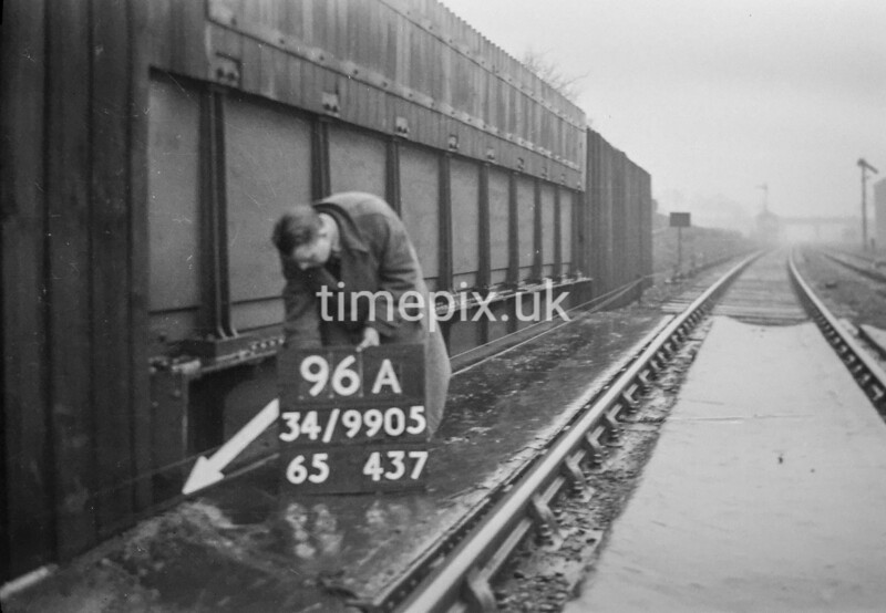 SD990596A3, Man marking Ordnance Survey minor control revision point with an arrow in 1950s