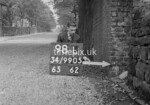 SD990598L, Man marking Ordnance Survey minor control revision point with an arrow in 1950s