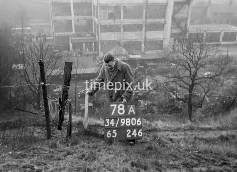 SD980678A, Man marking Ordnance Survey minor control revision point with an arrow in 1950s