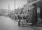 SD980766S, Man marking Ordnance Survey minor control revision point with an arrow in 1950s