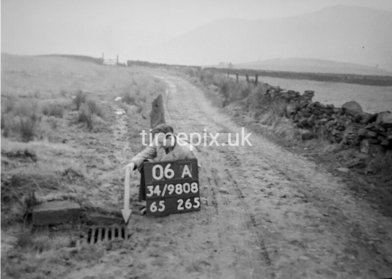 SD980806A, Man marking Ordnance Survey minor control revision point with an arrow in 1950s