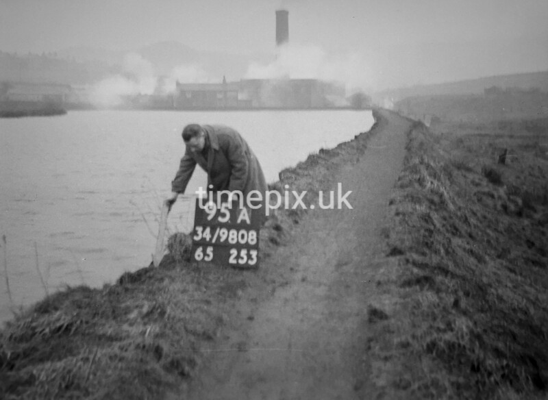 SD980895A, Man marking Ordnance Survey minor control revision point with an arrow in 1950s