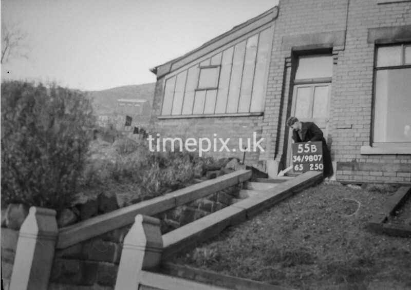 SD980755B, Man marking Ordnance Survey minor control revision point with an arrow in 1950s