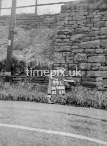 SD980699L1, Man marking Ordnance Survey minor control revision point with an arrow in 1950s