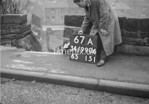 SD990667A2, Man marking Ordnance Survey minor control revision point with an arrow in 1950s