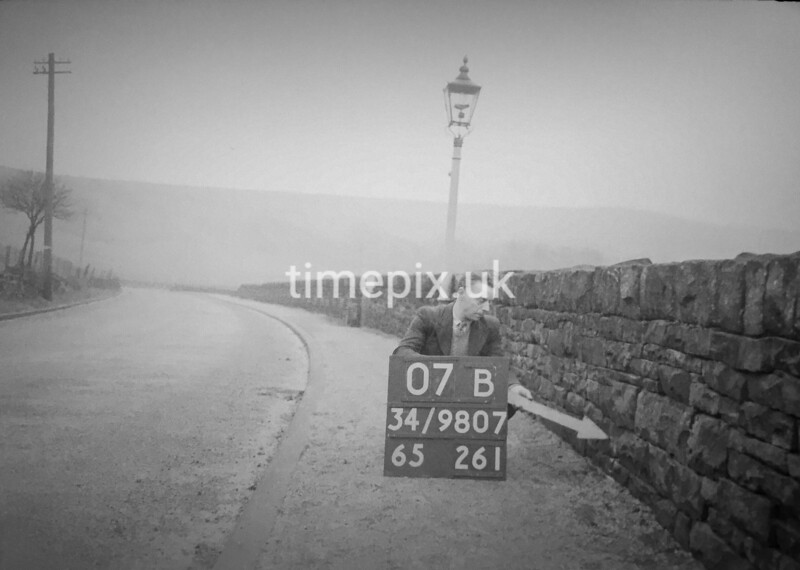 SD980707B, Man marking Ordnance Survey minor control revision point with an arrow in 1950s
