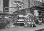 SD990605B1, Man marking Ordnance Survey minor control revision point with an arrow in 1950s