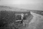SD980515B, Man marking Ordnance Survey minor control revision point with an arrow in 1950s