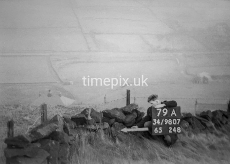 SD980779A, Man marking Ordnance Survey minor control revision point with an arrow in 1950s
