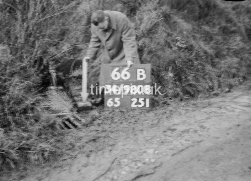 SD980866B, Man marking Ordnance Survey minor control revision point with an arrow in 1950s