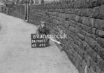 SD980769A1, Man marking Ordnance Survey minor control revision point with an arrow in 1950s
