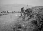 SD980635A, Man marking Ordnance Survey minor control revision point with an arrow in 1950s