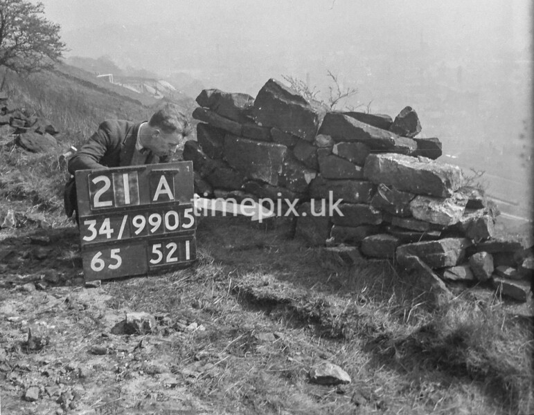 SD990521A2, Man marking Ordnance Survey minor control revision point with an arrow in 1950s