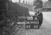 SD990588A, Man marking Ordnance Survey minor control revision point with an arrow in 1950s