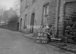 SD980784A, Man marking Ordnance Survey minor control revision point with an arrow in 1950s