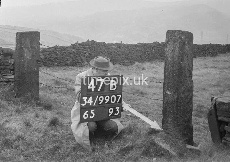 SD990747B, Man marking Ordnance Survey minor control revision point with an arrow in 1950s
