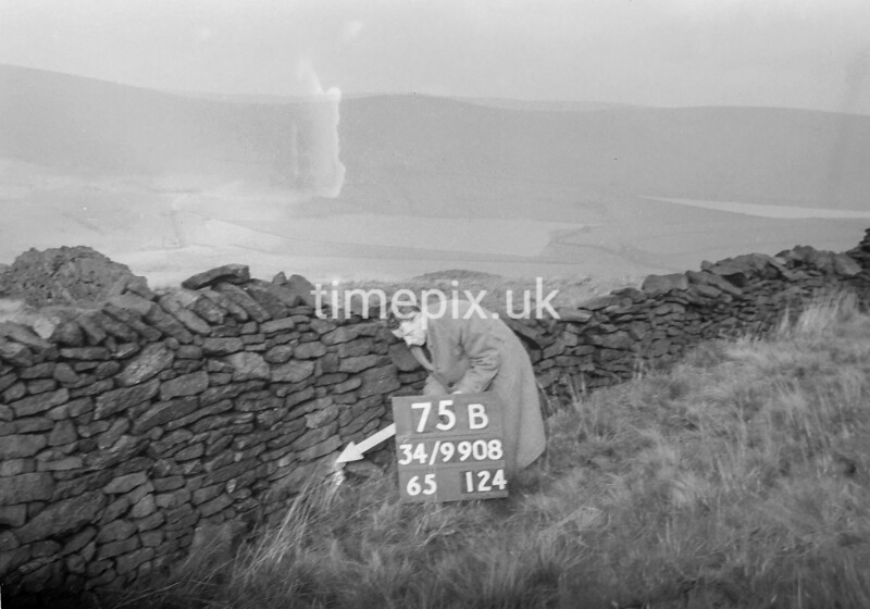 SD990875B, Man marking Ordnance Survey minor control revision point with an arrow in 1950s