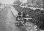 SD980842A, Man marking Ordnance Survey minor control revision point with an arrow in 1950s