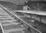 SD990665B, Man marking Ordnance Survey minor control revision point with an arrow in 1950s