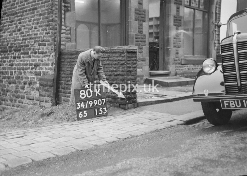 SD990780K1, Man marking Ordnance Survey minor control revision point with an arrow in 1950s