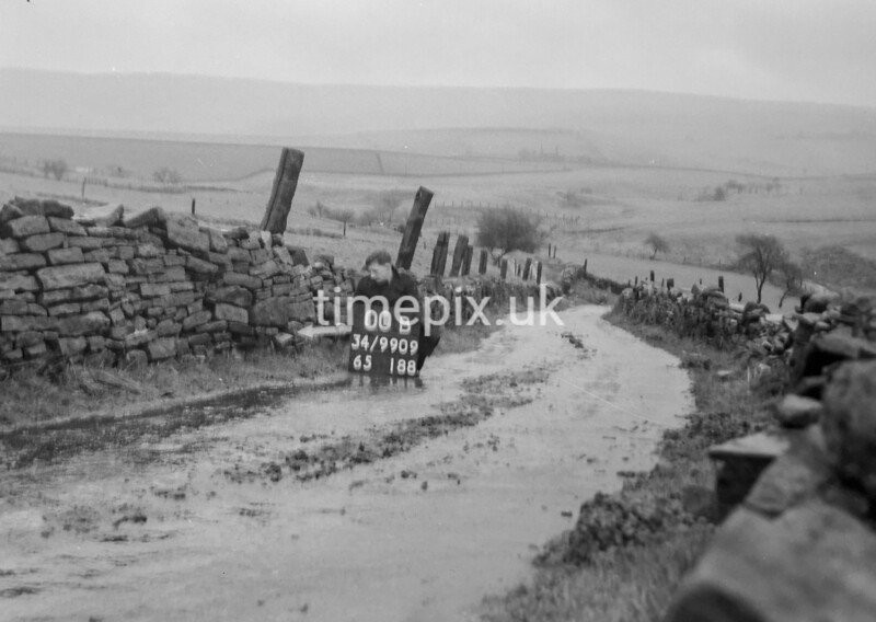SD990900B, Man marking Ordnance Survey minor control revision point with an arrow in 1950s