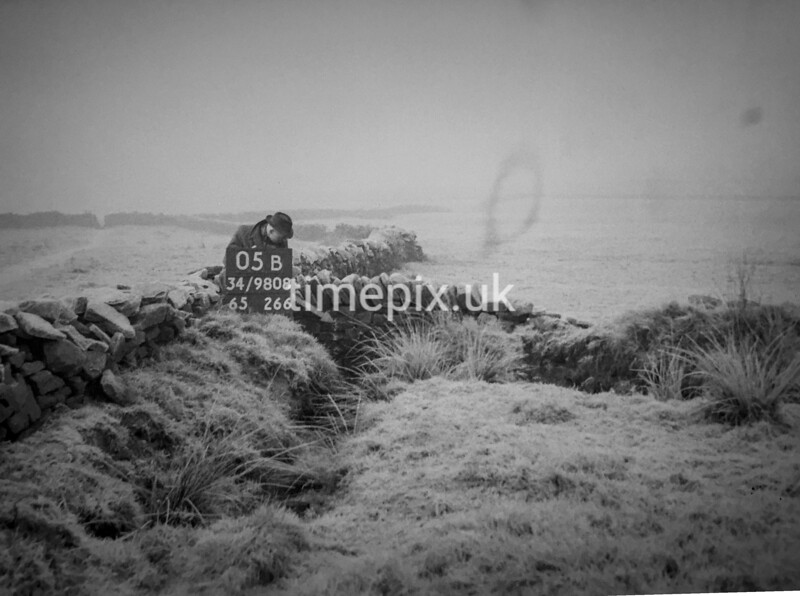 SD980805B, Man marking Ordnance Survey minor control revision point with an arrow in 1950s