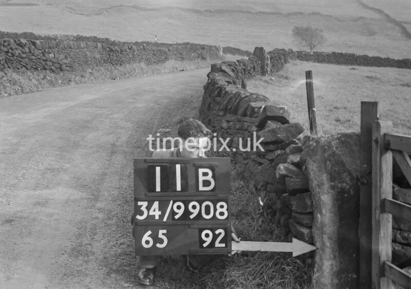 SD990811B2, Man marking Ordnance Survey minor control revision point with an arrow in 1950s