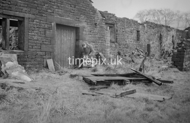SD990849A, Man marking Ordnance Survey minor control revision point with an arrow in 1950s