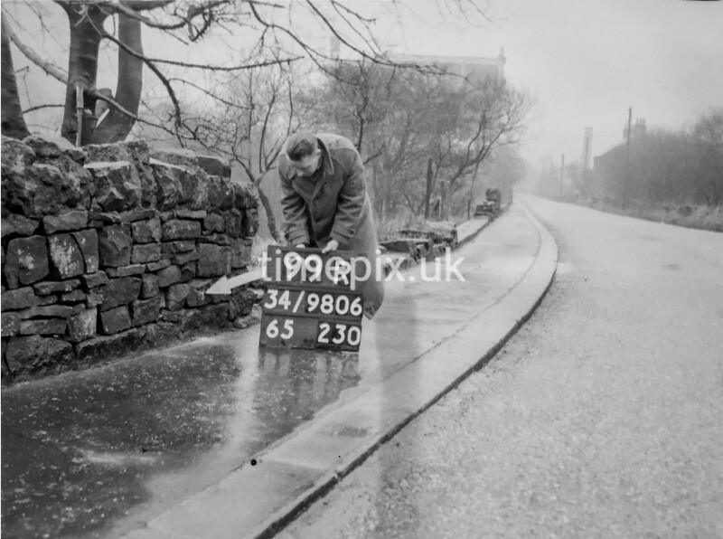 SD980699R, Man marking Ordnance Survey minor control revision point with an arrow in 1950s